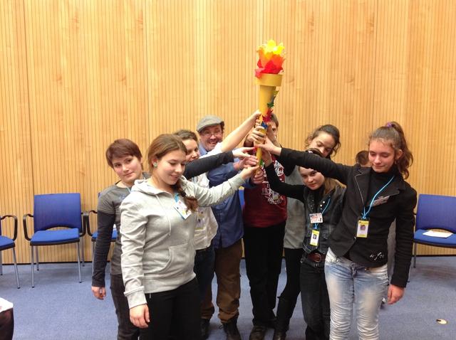Zero Project Participants Holding Torch