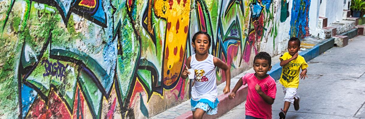 Children running through streets in Cartagena