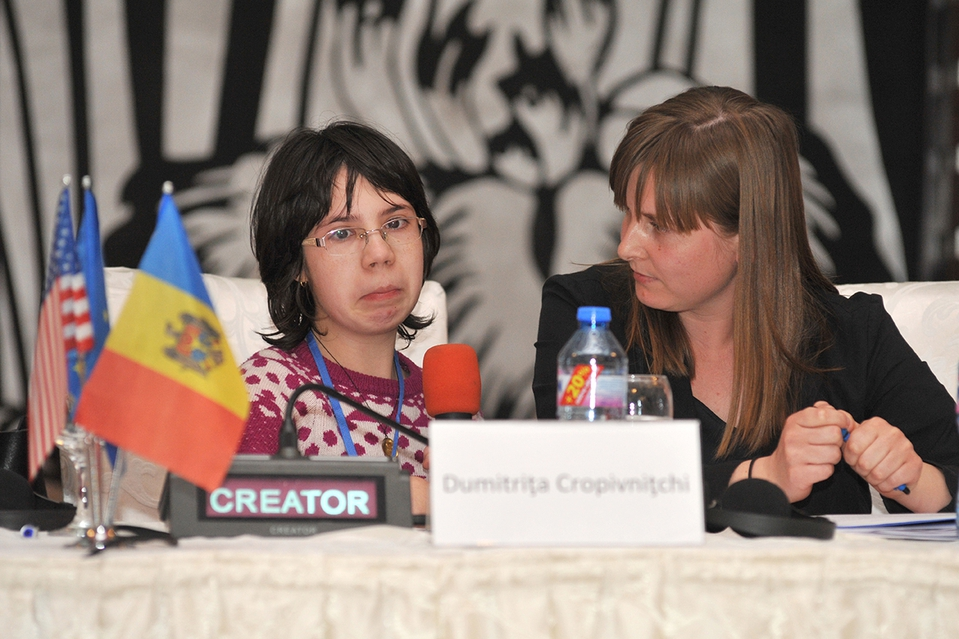 Lumos Young Advocate Dumitrita attends a conference on deinstitutionalisation in 2016