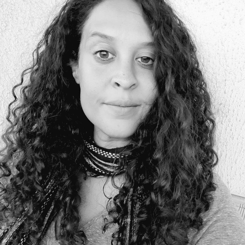 A portrait shot of Valerie Noisette in black and white