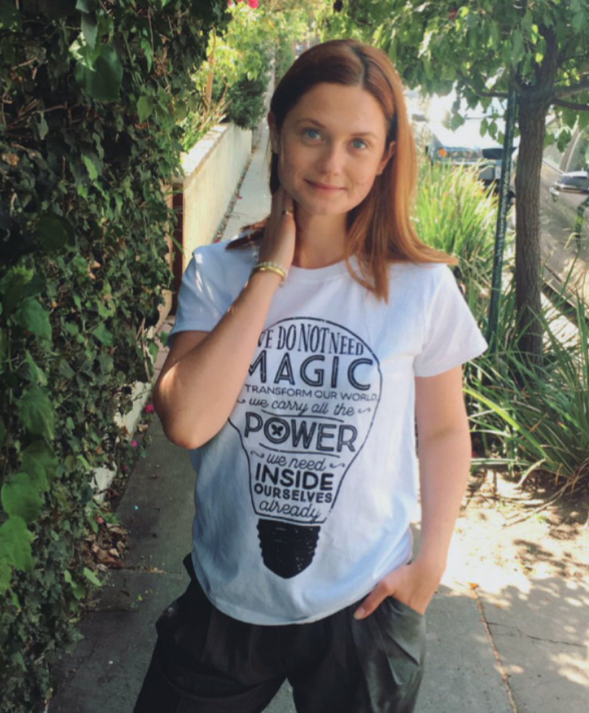 Bonnie Wright in a Lumos t-shirt
