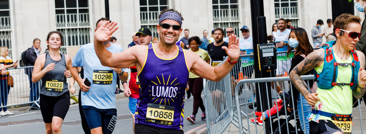A runner with his hands up at the London Landmarks Half Marathon