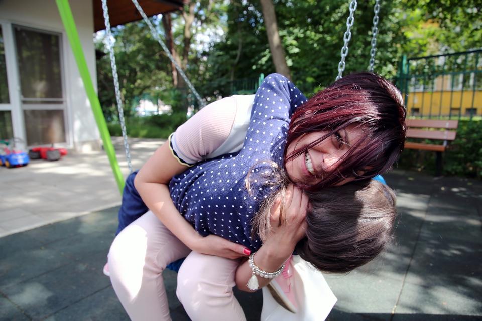 Renetta hugs her foster child
